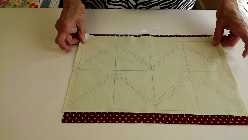 Place the light fabric with the transferred SQangle lines on the darker fabric - right sides together.