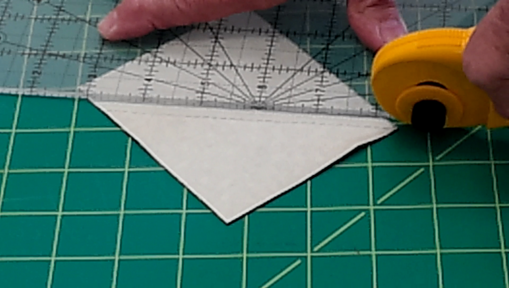 Cut on the diagonal solid lines.