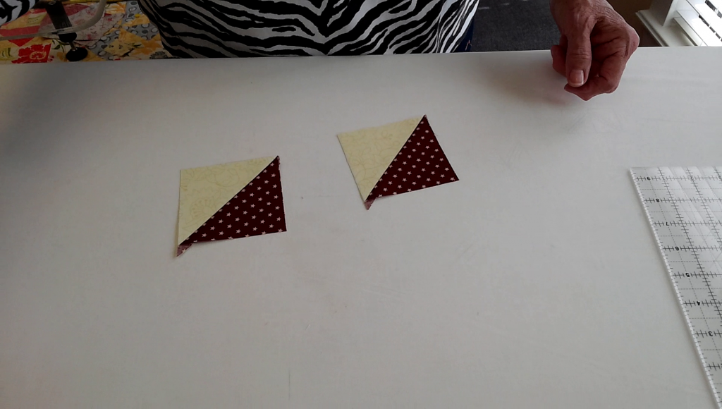 Press each triangle open and you have lots of Super Quick and highly accurate half square triangles.